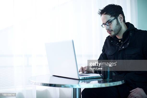 Native Young Entrepreneur on Laptop