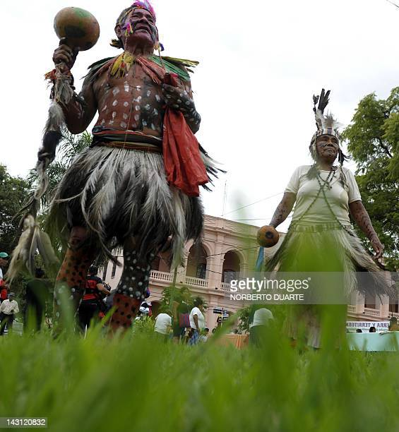 Natives of an indigenous ethnic group dance as they take part in a protest during the commemoration of the American Indigenous People Day on April 19...