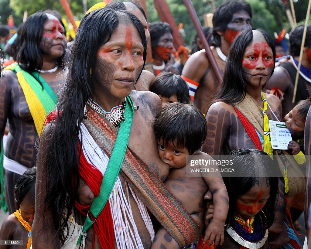 Natives of several tribes march to bring attention to saving the Amazon forest in Belem in Para in the heart of the Brazilian Amazon on January 27 on...