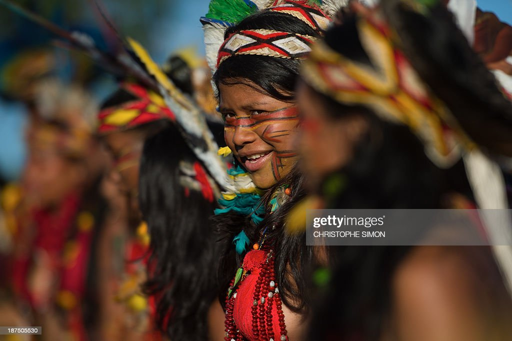 Natives wait for the start of the opening ceremony of the International Games of Indigenous Peoples, in Cuiaba, state of Mato Grosso, on November 9, 2013. 48 Brazilian ethnic groups and indigenous representatives from 16 countries are taking part in the event which runs until November 16.