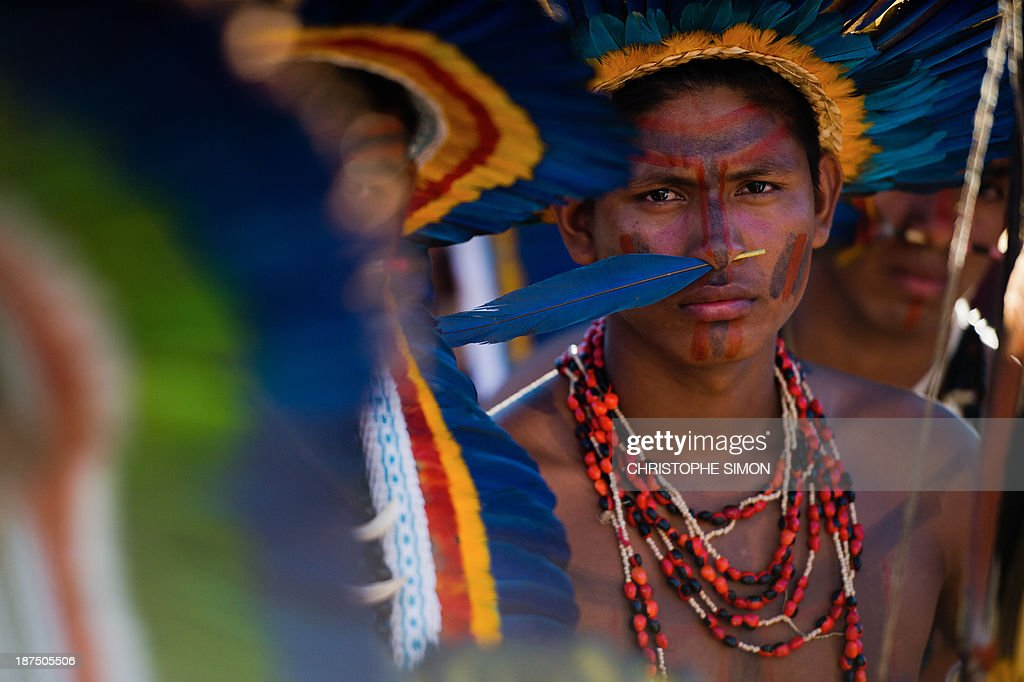 Natives wait for thye start of the opening ceremony of the International Games of Indigenous Peoples, in Cuiaba, state of Mato Grosso, on November 9, 2013. 48 Brazilian ethnic groups and indigenous representatives from 16 countries are taking part in the event which runs until November 16. AFP PHOTO / CHRISTOPHE SIMON