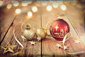 Nativity Christmas Ornaments with Decorations and Ribbon on Old Wood Background