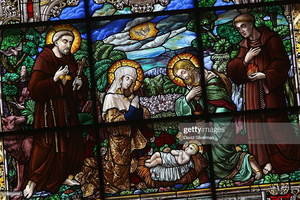 A nativity scene is displayed in the stainedglass window in St Catherine's Church December 21 2007 in Bethlehem in the West Bank St Catherine's which...