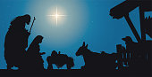 Nativity Scene Jesus in a Manger with Joseph and Mary. Blue background with star.