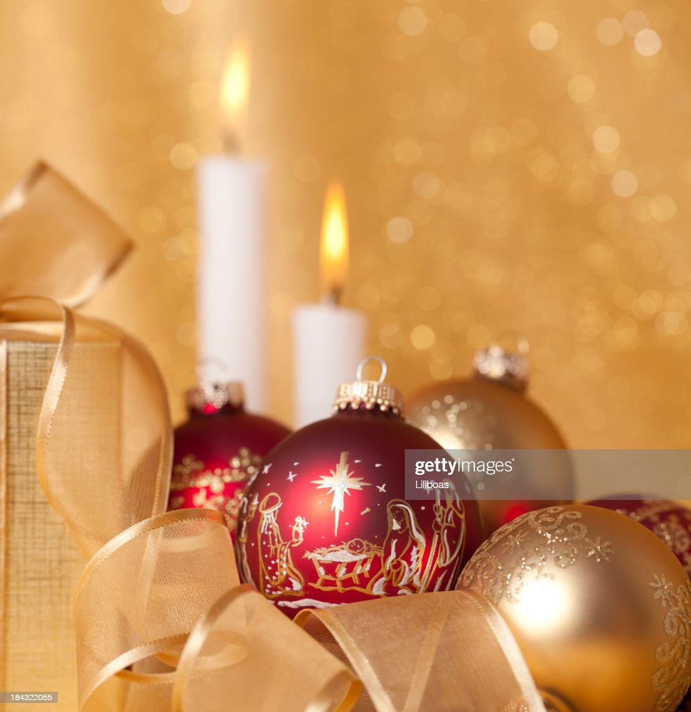 Nativity scene ornaments and christmas candles stock photo for Christmas candles and ornaments