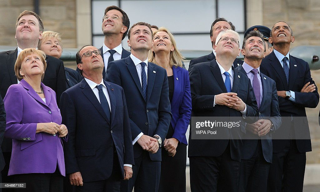 Nato leaders watch a flypast of military aircraft from Nato member countries on the final day of the summit at the Celtic Manor Resort in Newport on...