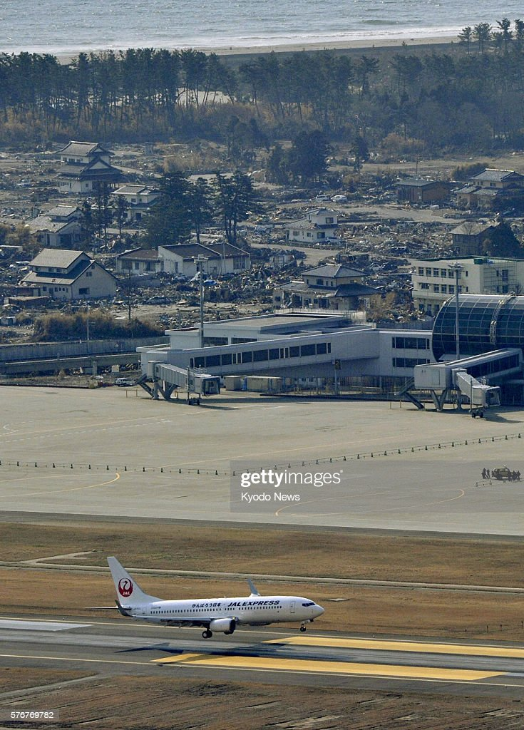 Natori Japan A Japan Airlines flight lands at Sendai Airport northeastern Japan at around 8 am on April 13 as the airport partially resumed domestic...