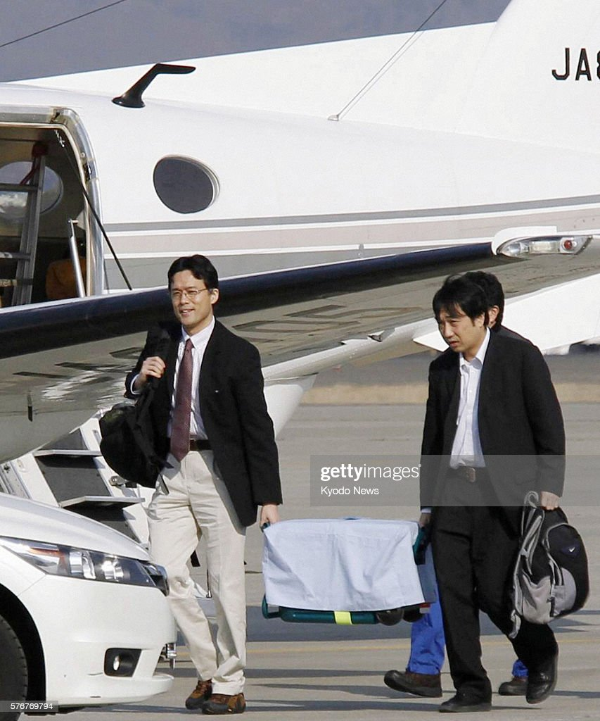 Natori Japan A medical team arrives at Sendai Airport in Miyagi Prefecture on a chartered flight on April 13 carrying a cooler box containing lungs...