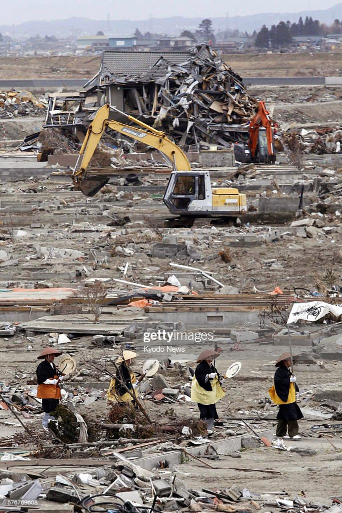 Natori Japan Buddhist monks walk through debris in Natori Miyagi Prefecture on April 11 a month after a massive earthquake and tsunami devastated the...