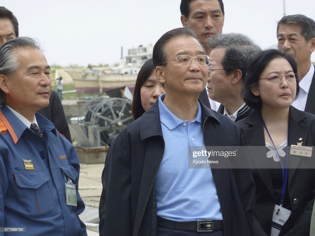 Natori Japan Chinese Premier Wen Jiabao is being briefed about the damage caused by the March 11 quaketriggered tsunami in Natori Miyagi Prefecture...
