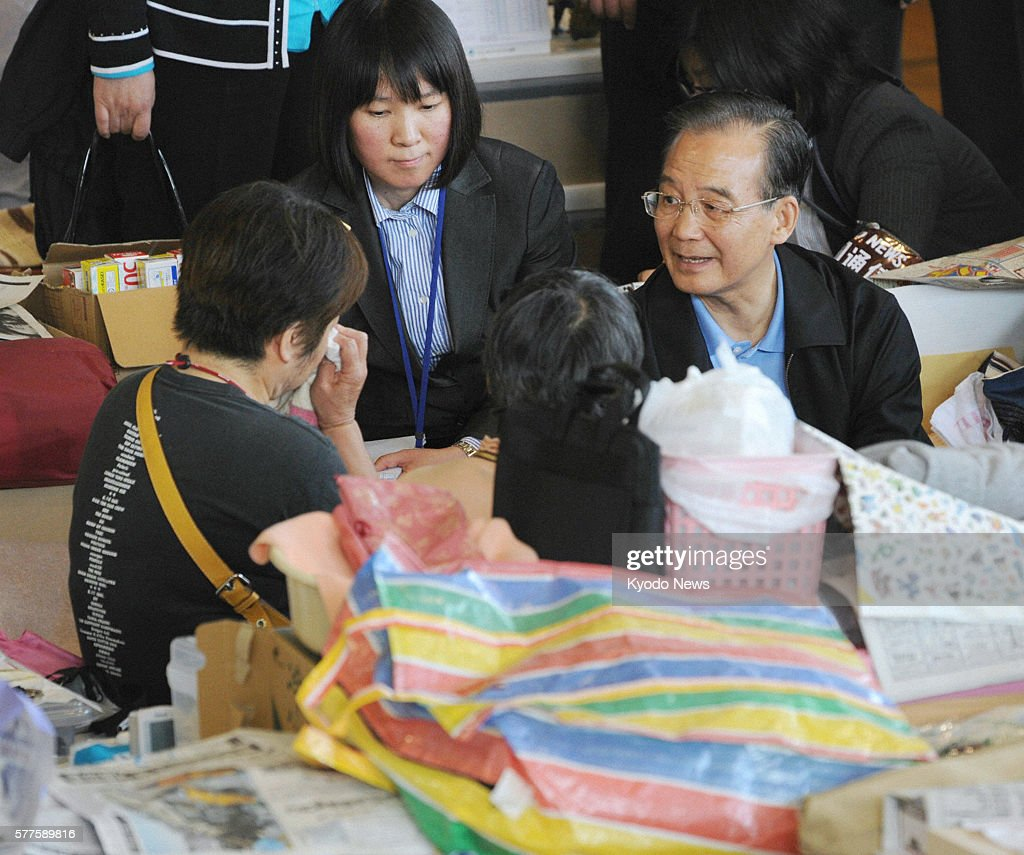 Natori Japan Chinese Premier Wen Jiabao speaks to survivors of the March 11 earthquake and tsunami at an evacuation center in Natori Miyagi...