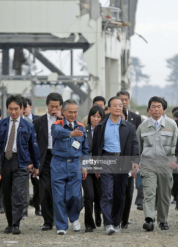 Natori Japan Chinese Premier Wen Jiabao visits a disasterhit site that used to be a local fish market in Natori Miyagi Prefecture on May 21 prior to...