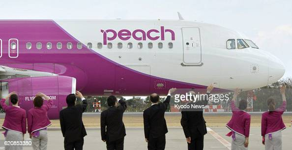 Natori Japan Officials and workers wave to the first flight of Peach Aviation Ltd leaving Sendai Airport for Kansai International Airport on April 12...