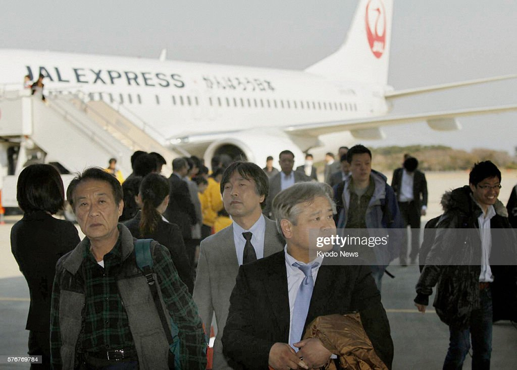 Natori Japan Passengers disembark from a Japan Airlines flight that landed at Sendai Airport northeastern Japan on the morning of April 13 as the...