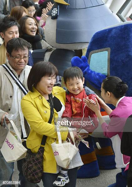 Natori Japan Passengers head to board the first flight of Peach Aviation Ltd at Sendai Airport on April 12 2013 The Japanese lowcost carrier launched...