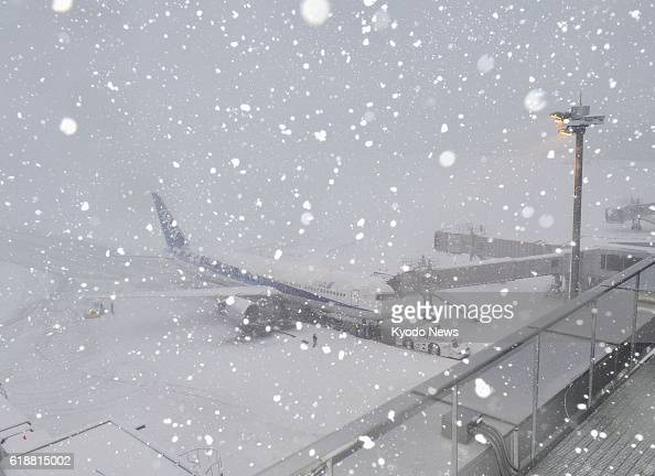 Natori Japan Photo shows Sendai airport in Miyagi Prefecture northeastern Japan where the runways were closed due to heavy snow on Jan 14 2013