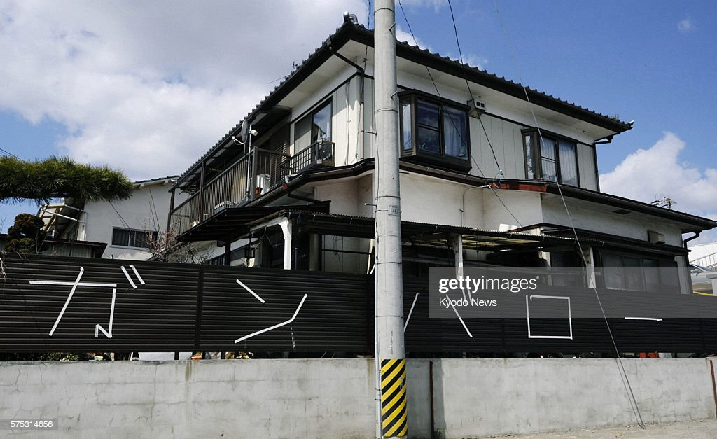 Natori Japan Photo taken March 28 shows the fence of a house in Natori Miyagi Prefecture displaying the message ''Gambaro'' meaning ''Hang in there''...