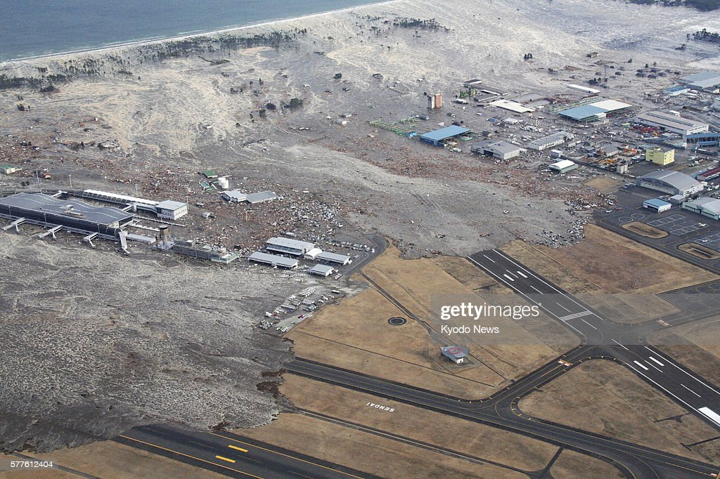 Natori Japan Supplied photo shows Sendai Airport being hit by a massive tsunami on March 11 2011
