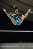 Natsumi Sasada of Japan competes in the Uneven Bars during day one of the Artistic Gymnastics NHK Trophy at Yoyogi National Gymnasium on June 7 2014...