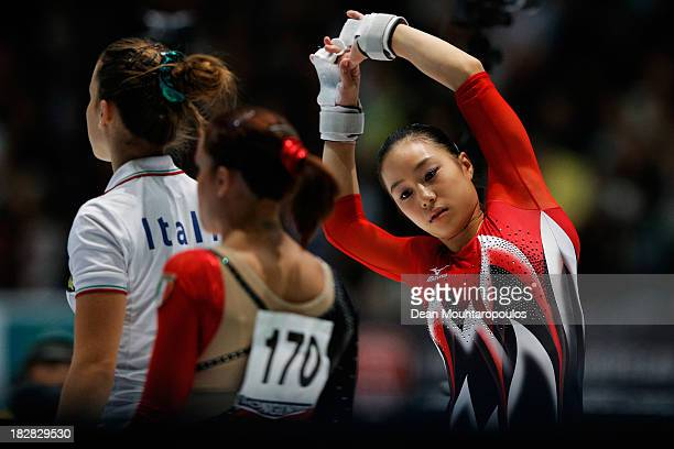 Natsumi Sasada of Japan warms up before she competes in the Womens Uneven Bars Qualification on Day Three of the Artistic Gymnastics World...