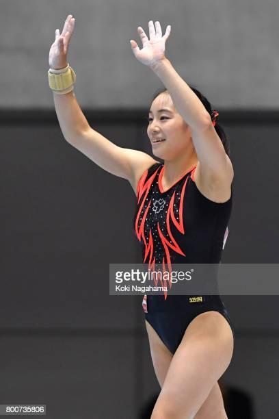 Natsumi Sasada waves for fans after competing on the balance beam during Japan National Gymnastics Apparatus Championships at the Takasaki Arena on...