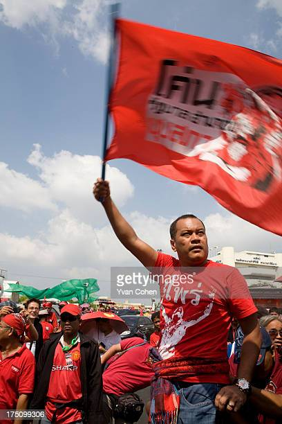 Nattawut Saikua one of the key leaders of the United Front for Democracy Against Dictatorship dubbed the red shirts waves to protesters as they leave...