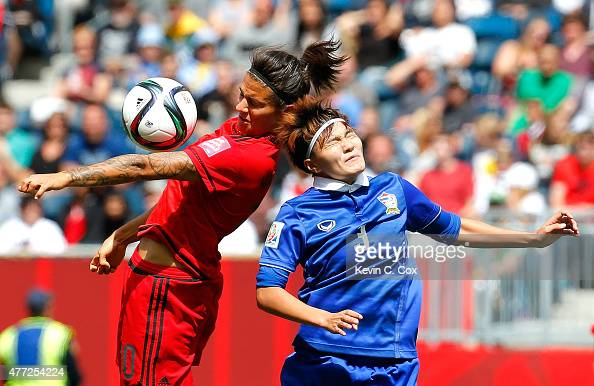 Natthakarn Chinwong of Thailand challenges Dzsenifer Marozsan of Germany during the FIFA Women's World Cup Canada 2015 match between Thailand and...
