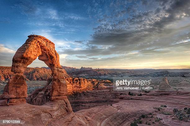 Natural Arch On Rocky Mountains At Arches National Park Against Cloudy Sky