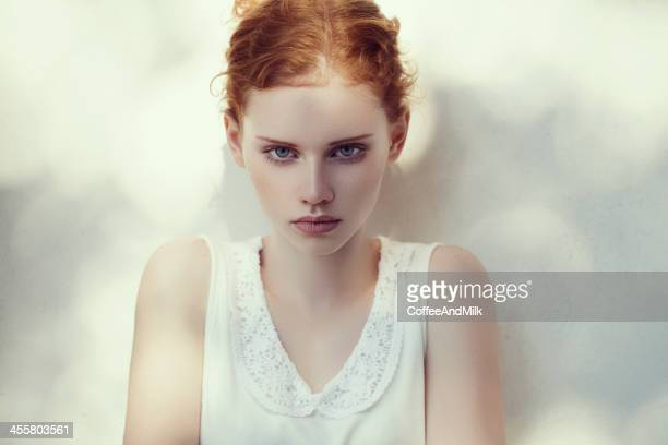 Natural beauty girl with red hair and blue eyes