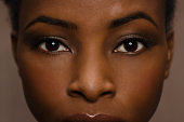 Afro-American woman with flawless skin and long eyelashes