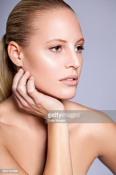 Natural Blond Woman with Hand Resting on Chin