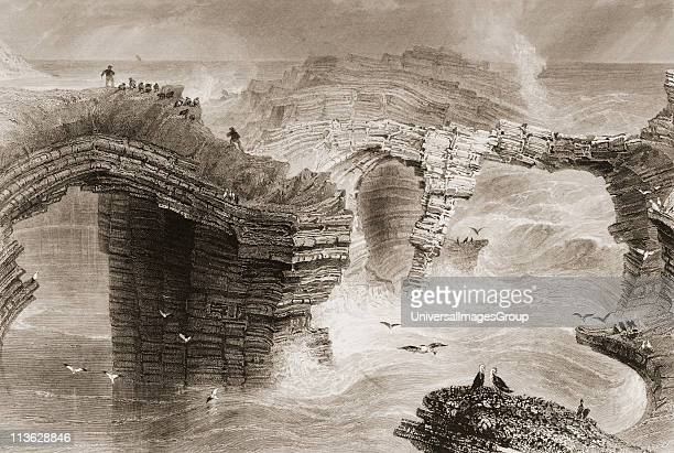Natural bridges near Kilkee County Clare Ireland Drawn by WHBartlett engraved by JC Bentley From 'The Scenery and Antiquities of Ireland' by NPWillis...