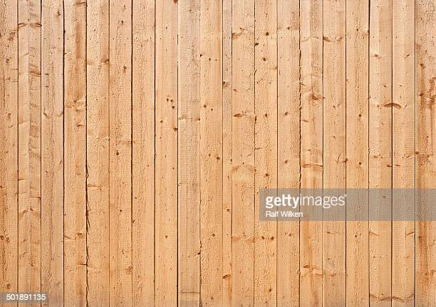 Natural colored wooden wall of rough boards