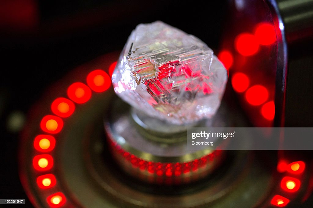 A natural diamond, unpolished and not rough cut, is scanned by a laser machine before being cut into two segments producing diamonds of 23,916 carats and 4,309 carats during the production process at OAO Alrosa's cutting and polishing unit, Brilliantly Alrosa, in Moscow, Russia, on Tuesday, Nov. 26, 2013. OAO Alrosa, Russia's diamond producer, raised about $1.3 billion in an oversubscribed share sale from investors including Oppenheimer Funds Inc. and Lazard Ltd.'s asset-management, as part of a state strategy to attract more international investors to Russia and establish Moscow as a global financial center. Photographer: Andrey Rudakov/Bloomberg via Getty Images