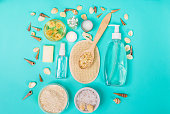 Natural domestic products for skincare on a blue background. Oat, oil, soap, facial cleanser. Top view. Still life. Copy space