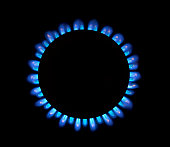Natural gas blue flames close up image