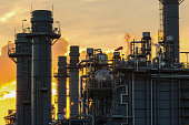 Natural Gas Combined Cycle Electrical Power Plant with golden hour