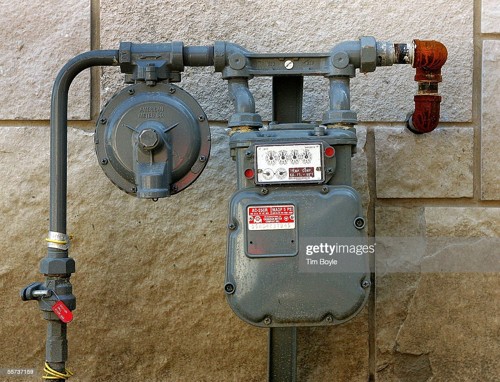 A Natural Gas Meter With Its Service Piping And Valve Is Shown Outside