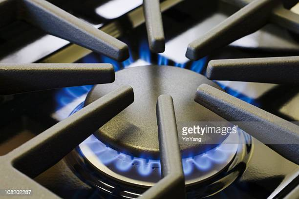 Natural Gas Stove Burner Appliance with Blue Flame Fire Close-up