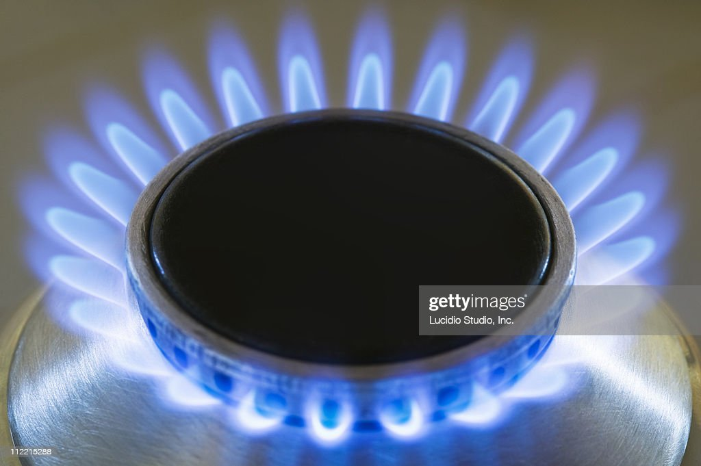 Natural gas stove burner showing blue flame