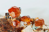Several crystals of natural gemstone garnet Spessartite on matrix, collectable specimen from China