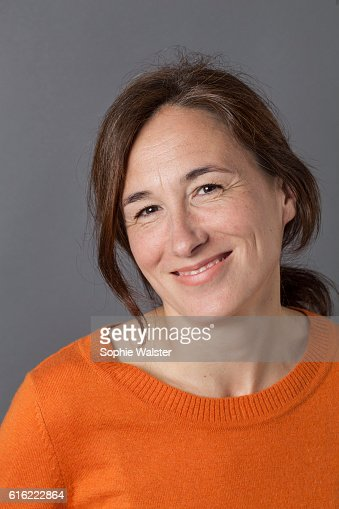 natural, gorgeous middle aged woman smiling for serenity and wellness : Foto stock