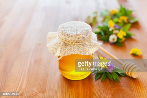 Natural honey with flowers : Stock Photo
