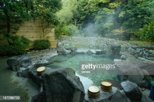Natural hot spring bath hakone japan stock photo getty for Spring bathrooms
