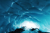 Natural ice cave in mountain, hiking and adventure