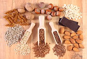 Ingredients and products containing magnesium and dietary fiber, healthy food and nutrition, wholemeal pasta, sunflower, buckwheat, brown rice, linseed, almonds, chocolate, oatmeal, hazelnut, walnut