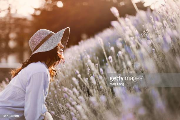 Natural light portrait by the lavender in Park Guell Barcelona Spain