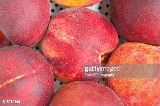 Natural red nectarines. Closeup : Foto de stock