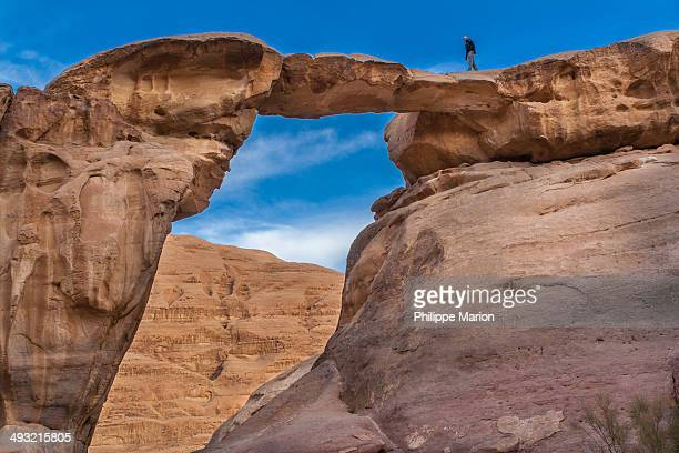 Natural rock arch bridge in Wadi Rum, Jordan