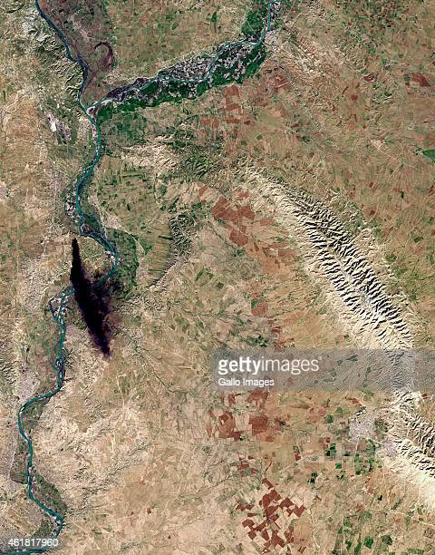 A Natural satellite view of a black plume of smoke from Manqur Atiq next to the Tigris River in the Nineveh Province on January 12 2015 Mosul Iraq
